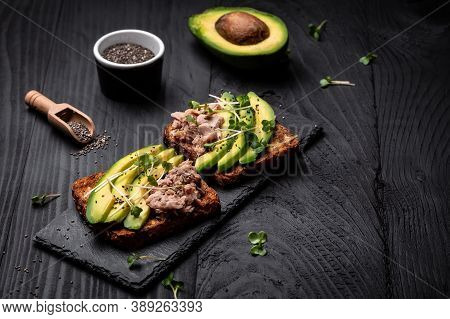 Sandwiches With Avocado And Tuna Fish, Microgreen, Wholemeal Bread. Delicious Breakfast Or Snack On