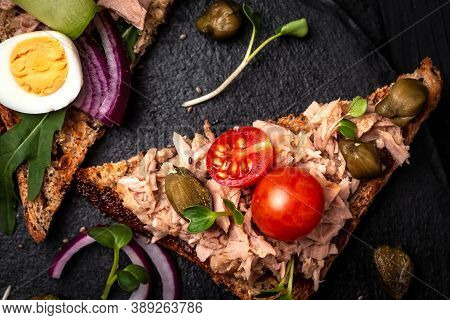 Appetizer Bruschetta With Tuna. Italian Bruschetta Sandwiches With Canned Tuna, Tomatoes And Capers.