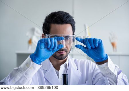 Attractive Scientist Medical Worker With Sample Test Covid-19 Or Coronavirus Tube At Laboratory , Do