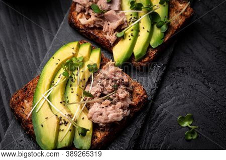 Sandwiches With Avocado And Tuna Fish, Microgreen, Wholemeal Bread. Delicious Breakfast Or Snack, To