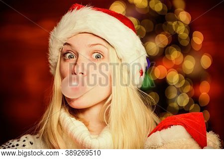 Only Fun On My Mind. Girl Santa Claus Making Big Bubble With Gum. Funny Face Close Up. Adorable Woma