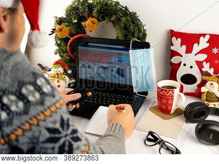 Ukraine, Kyiv - September 30, 2020: Christmas Online Shopping. Write A List And Hold A Credit Card.