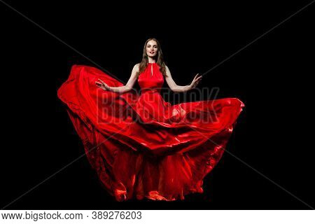 Beautiful Celebrity Young Woman In Red Silky Dress On Black Background