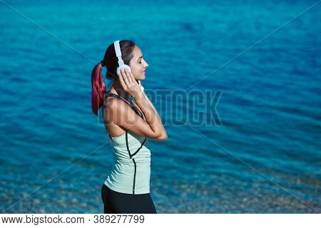 Meditation Time And Contemplation Nature Concept, Copy Space. Woman Enjoying Music In Headset. Calm
