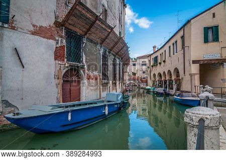 Venice, Italy - May 23, 2013: Typical Canals With Old Houses Venice