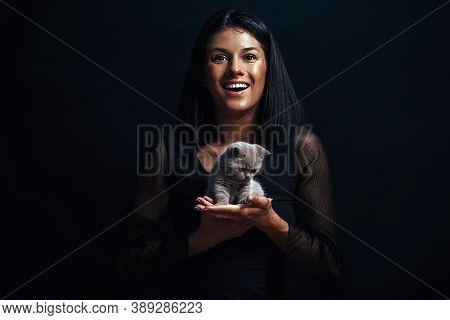 Beautiful Woman With A Bautiful Cat. Cat. Funny Photo.