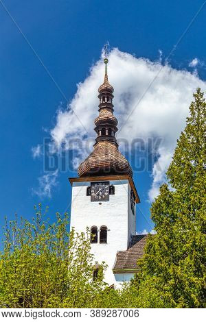 Church Tower In The Spania Dolina Village, Slovakia, Europe.