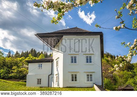 Historic Building With Sundial In The Spania Dolina Village, Slovakia, Europe.