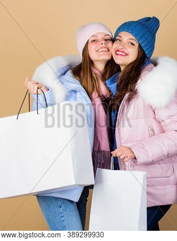 Buy Winter Clothes. Girls Wear Warm Jackets. Shopping Concept. Sale And Discount. Women Friends Shop