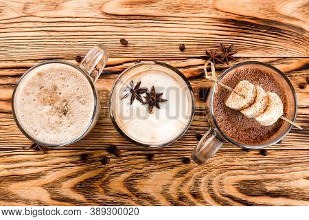 Hot Chocolate On Rustic Wooden Background, Top View Of Set Of Hot Drinks On A Wooden Table, Cocoa, H