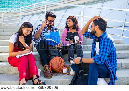 Group Of Young Female And Male College Students On Campus