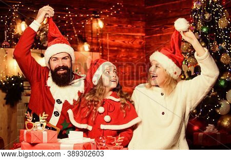 Small Child And Parents In Santa Hat. Lot Of Xmas Present Boxes. Winter Holidays. Happy Family Celeb