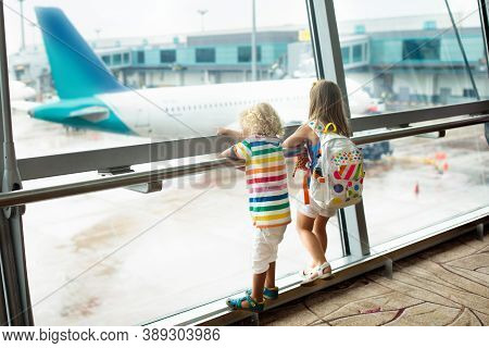 Kids At Airport. Children Look At Airplane. Traveling And Flying With Child. Family At Departure Gat