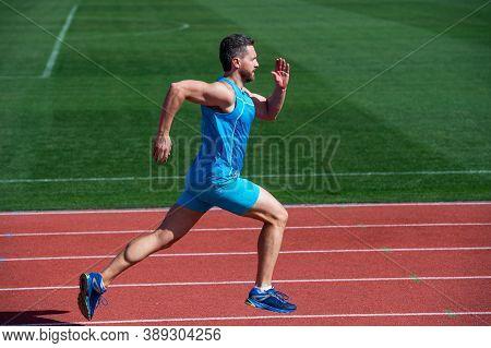 Great Progress. Muscular Guy Run To Success. Man Running On Stadium. Sports Healthy Lifestyle Routin