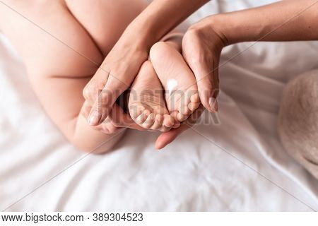 Hygiene - Young Mom Wiping The Baby Skin Body With Wet Wipes Carefully. Mother Changing The Baby Nap