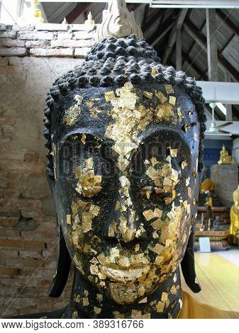 Ayutthaya, Thailand, January 24, 2013: Buddha Head With Gold Leaf In One Of The Temples Of Ayutthaya
