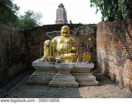 Ayutthaya, Tayutthaya, Thailand, January 24, 2013: Smiling Golden Buddha In One Of The Temples In Ay