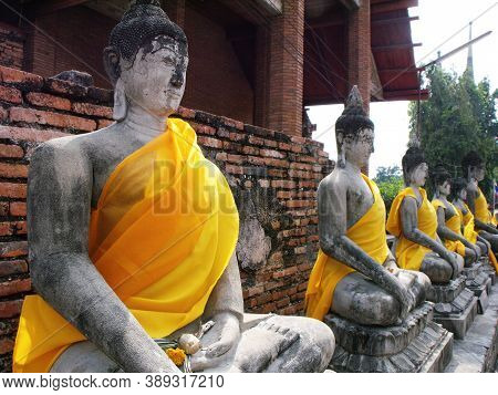 Ayutthaya, Thailand, January 24, 2013: Buddhas With Golden Cloth In Ayutthaya, Former Capital Of The