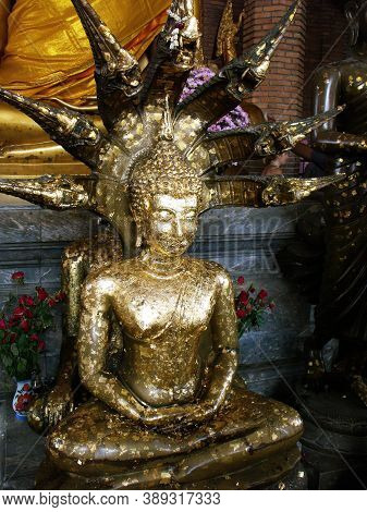 Ayutthaya, Thailand, January 24, 2013: One Of The Different Sculptures Of Buddha Covered With Gold L