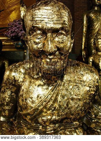 Ayutthaya, Thailand, January 24, 2013: Sculpture Of A Revered Monk Covered With Gold Leaf In A Templ