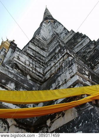 Ayutthaya, Thailand, January 24, 2013: Golden Fabrics On A Stupa In Ayutthaya, Former Capital Of The