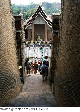 Ayutthaya, Thailand, January 24, 2013: Visitors On The Stairs Of A Stupa In Ayutthaya, Former Capita