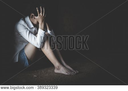 Young Depressed Woman, Domestic And Rape Violence,beaten And Raped Sitting In The Corner,  Copy Spac