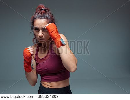 Large Portrait Of A Female Mixed Martial Arts Fighter With A Bandage On His Hands