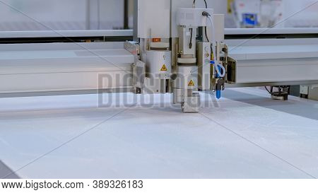 High Precision Digital Cutting System - Flatbed Cutter, Router During Work With Plastic Sheet At Fac