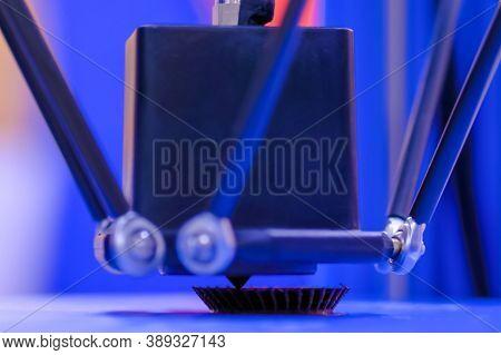 Print Head Of 3d Printer Machine Printing Plastic Model Against Blue Background At Modern Scifi Tech
