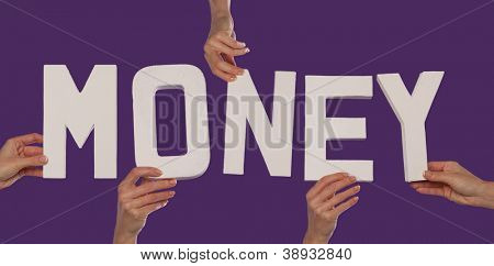 White alphabet lettering spelling MONEY held up over a purple studio background by outstreched female hands
