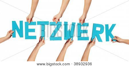 Turquoise blue alphabet lettering spelling NETZWERK held up over an isolated white background by female hands