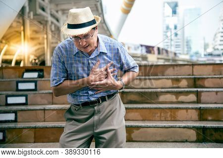 Asian Old Man, Are Suffering From Angina Due To Heart Disease, While He Was On The Train Station, To
