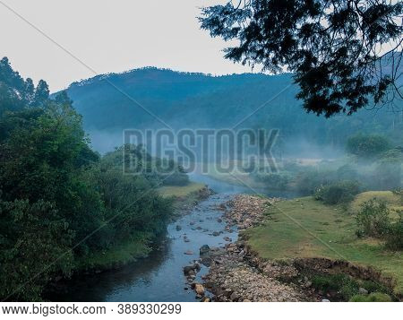 A Foggy Early Morning View At A Stream In Munnar, In The Southern Indian State Of Kerala.