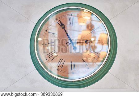 Large Wall Clock Which Reflects The Room. Watch Glass Reflection Light From The Chandeliers In The A