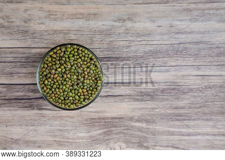 Organic Mung Beans On Wooden Table. Green Beans, Dried Mung Beans. Vegan Raw Ingredients Organic Far