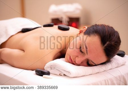 Woman Lying On The Table In Spa And Relaxing