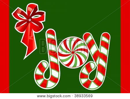 Word JOY made of candycanes - copyspace