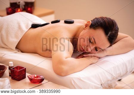 Middle Aged Woman Lying On The Table In The Massage Center