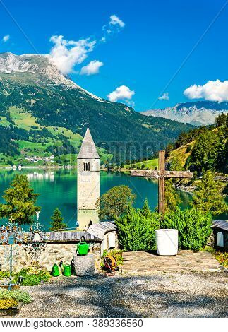 Submerged Bell Tower Of Curon And A Graveyard At Graun Im Vinschgau On Lake Reschen In South Tyrol,