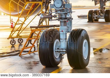 One Of The Front Landing Gear Under The Fuselage Of The Aircraft