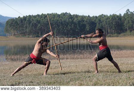 Indian Fighters With Bamboo Stick Performing Kalaripayattu Marital Art Demonstration With Bamboo Sti