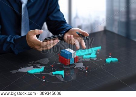 Businessman shows export container on digital world map screen