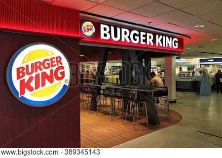 Birmingham, Uk - April 24, 2013: Travelers Visit Burger King At Birmingham International Airport, Uk