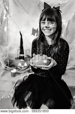 Halloween Home Party. Black And White Selective Focus Portrait Of Cute Smiling Teen Girl In Black Ca
