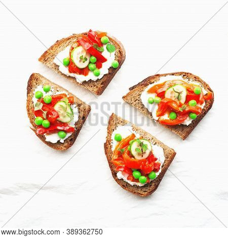 Grain Bread Slices For Sandwiches With Curd Cheese, Baked Capsicum, Green Fresh Peas And Mint On A L