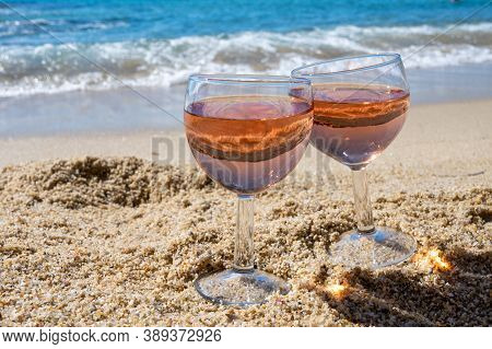 Two Glasses Of Local Rose Wine On White Sandy Beach And Blue Mediterranean Sea On Background, Near L