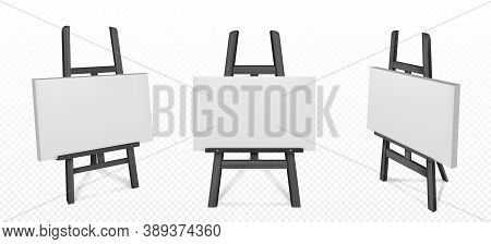 Black Wooden Easel With White Canvas In Front And Angle View. Vector Realistic Mockup Of Wood Stand
