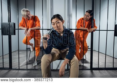 Asian Womens Prison. In The Cell There Are Two Young Girls Convicted Of A Criminal Offense And A Fem