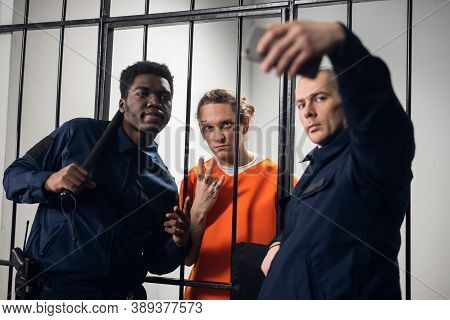 Wardens In A Maximum Security Prison Take Selfies With A Prisoner With Tattoos On His Face, Who Is S